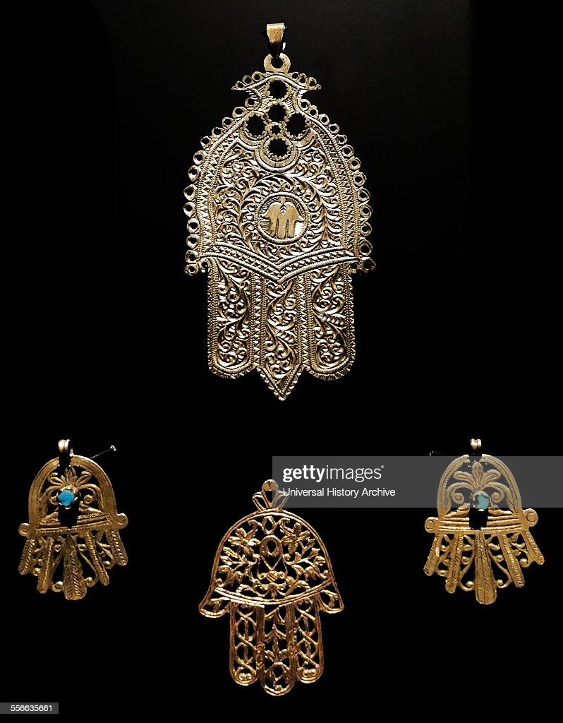 Gold palm shaped amulet, known as, the Hamsa throughout the Middle East and Africa. Dated 18th Century. : News Photo