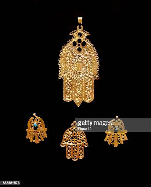 Gold palm shaped amulet known as the Hamsa throughout the Middle East and Africa Dated 18th Century