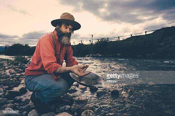 gold panning,successful prospector with nugget - gold rush stock photos and pictures