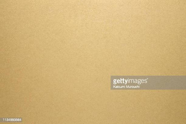 gold paper texture background - gold coloured stock pictures, royalty-free photos & images
