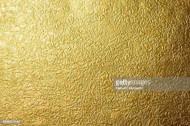 gold paper texture background - gilded stock pictures, royalty-free photos & images