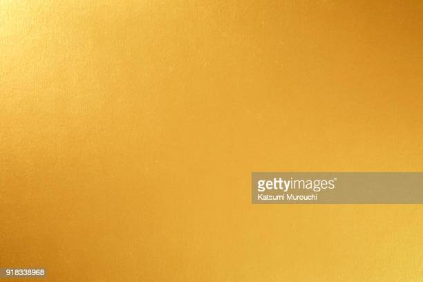 gold paper texture background - gold colored stock pictures, royalty-free photos & images