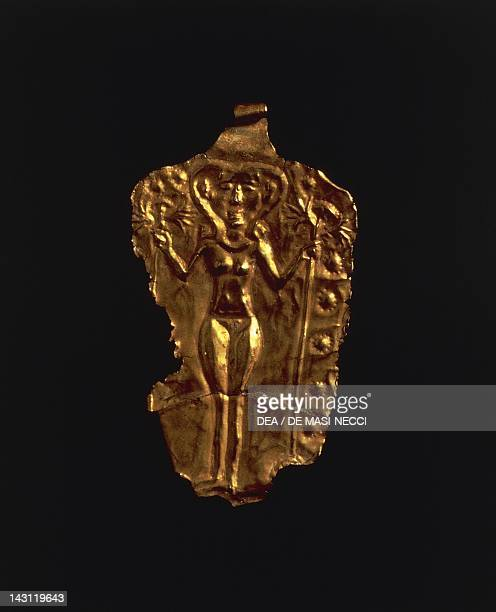 Gold pendant with stylized figure of a goddess Artefact from Ugarit Syria Assyrian civilisation 1400200 BC Aleppo Archaeological Museum