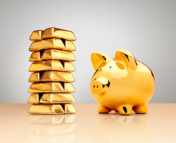Gold Piggy Bank Beside A Stack Of Ingots Wall Art