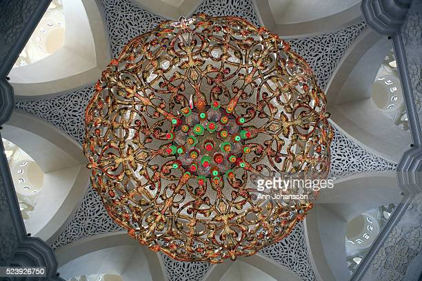 A gold plated crystal chandelier hangs in the main prayer hall at the Sheikh Zayed bin Sultan alNahyan Mosque in Abu Dhabi December 29 2012