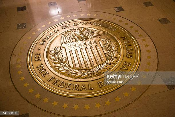 A gold plated seal outside inside the Eccles Building the place of the Board of Governors of the Federal Reserve System and of the Federal Open...