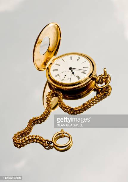 gold pocket watch and chain - gold stock pictures, royalty-free photos & images