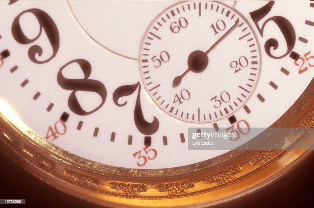 Gold pocket watch : Stock Photo