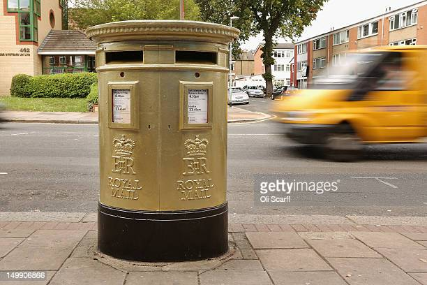 A gold post box in Isleworth on August 6 2012 in London England The post box was painted gold to celebrate British athlete Mo Farah's victory in the...