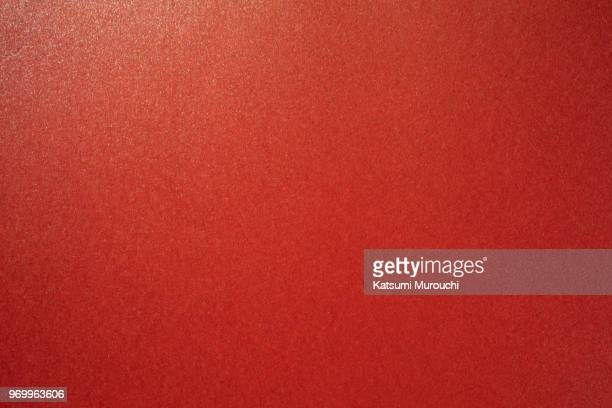 gold powder red paper texture background - rood stockfoto's en -beelden