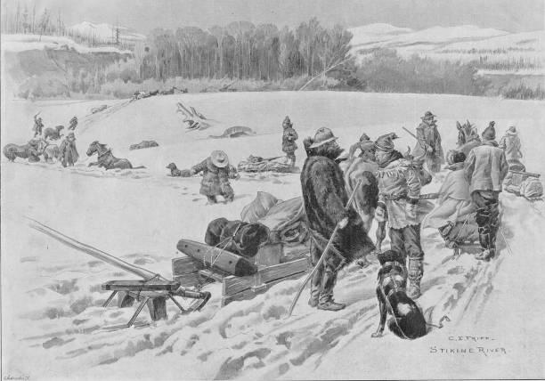 Gold prospectors crossing a snowdrift on the Stikine...