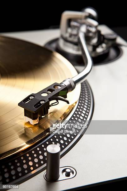 A gold record on a turntable