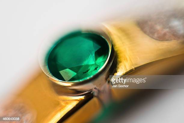 A gold ring with a fine emerald is seen in a jewelry workshop on February 08 2014 in Bogota Colombia Around 60% of the world's emerald production...