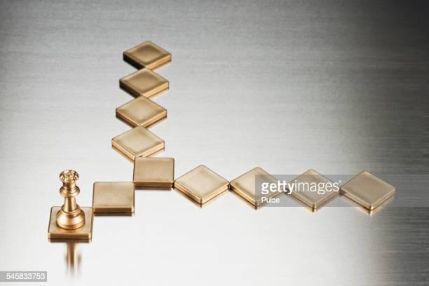 Gold rook on gold tile