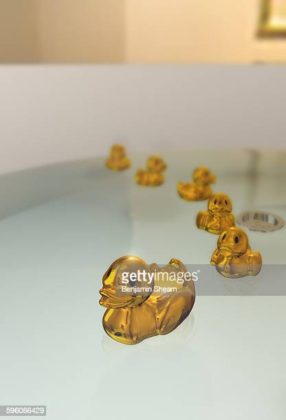Gold rubber ducky and ducklings