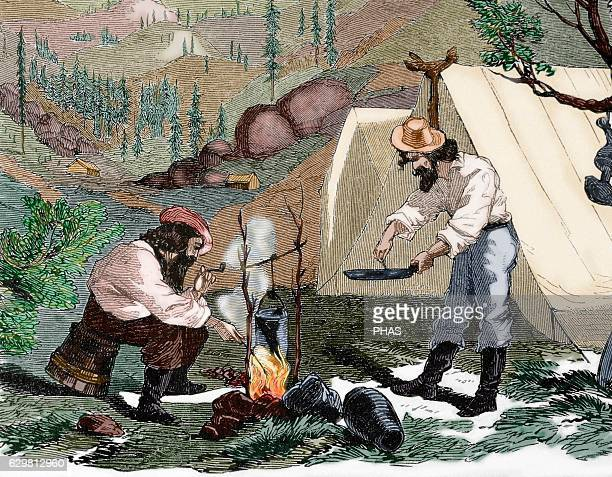 USA Gold Rush 19th century Gold prospectors cook at the camp by night Engraving at 'Harper's Weekly' 1857 Colored