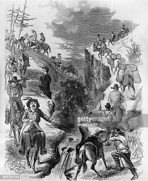 Gold rush California 18481854 Gold diggers on their way to new digging grounds crossing a ravine about 1850wood engraving 19th cent