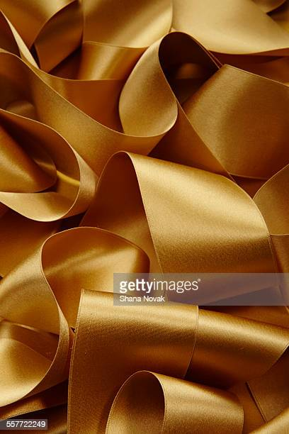 gold satin ribbon - ribbon stock pictures, royalty-free photos & images