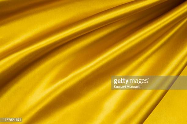 gold satin textured background material - silk stock pictures, royalty-free photos & images