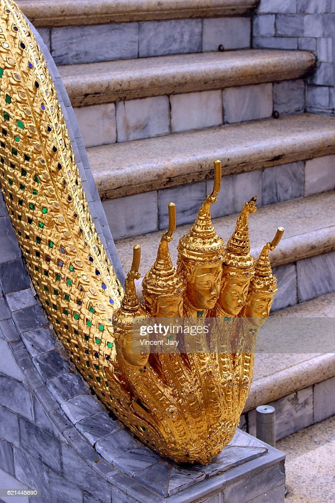 Gold sculpture snake and Buddha heads Bangkok Thailand : Photo