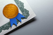 Gold Seal With Blue Ribbon On A Certificate Of Achievement
