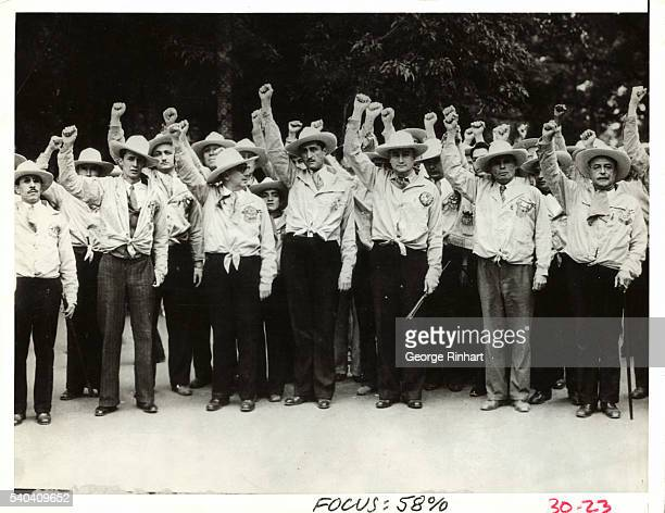 Gold Shirts Mexican Fascists are shown giving the Communist or clenched fist salute