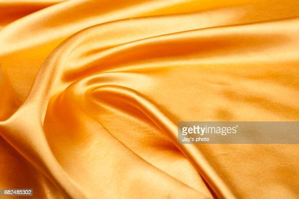 gold silk texture - satin ストックフォトと画像