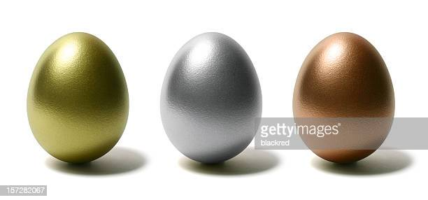 Gold Silver and Bronze Eggs on White Background