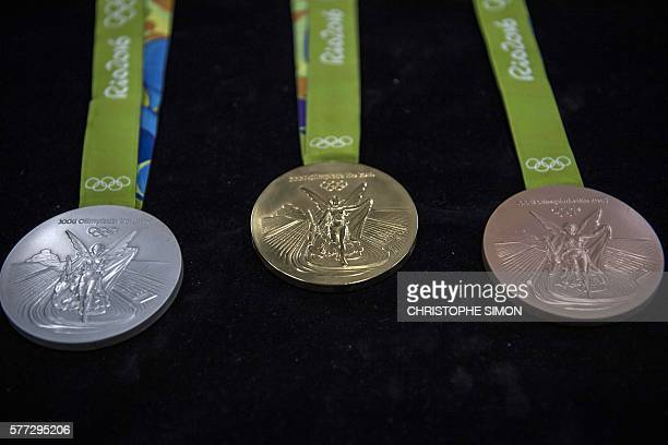 Gold silver and bronze medals for the Rio Olympic Games are displayed at a coin factory in Rio de Janeiro Brazil on July 18 2016 / AFP / CHRISTOPHE...
