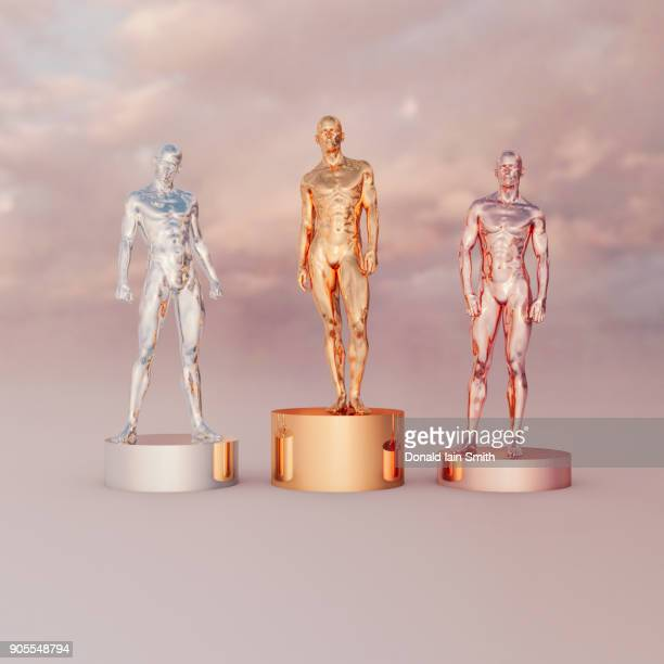 gold, silver and bronze men on pedestals - bronze medalist stock pictures, royalty-free photos & images