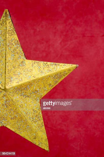 Gold star on red background