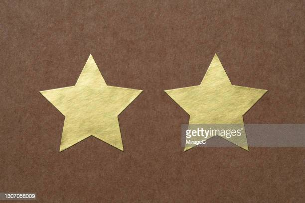 gold star shaped stickers - star shape stock pictures, royalty-free photos & images
