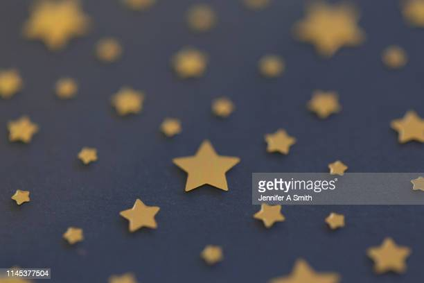 gold stars on navy background - navy blue stock pictures, royalty-free photos & images