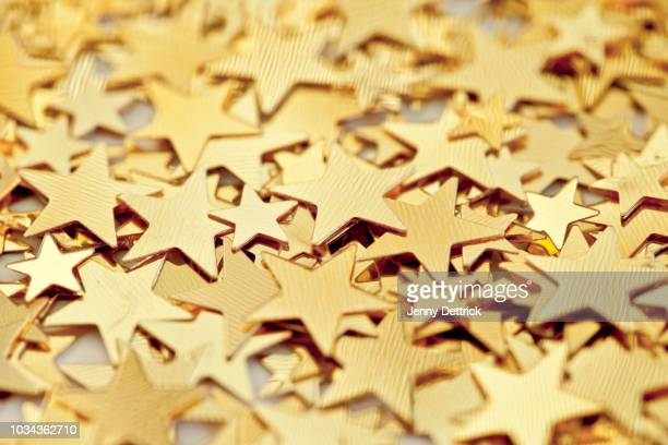 gold stars - gold star stock pictures, royalty-free photos & images