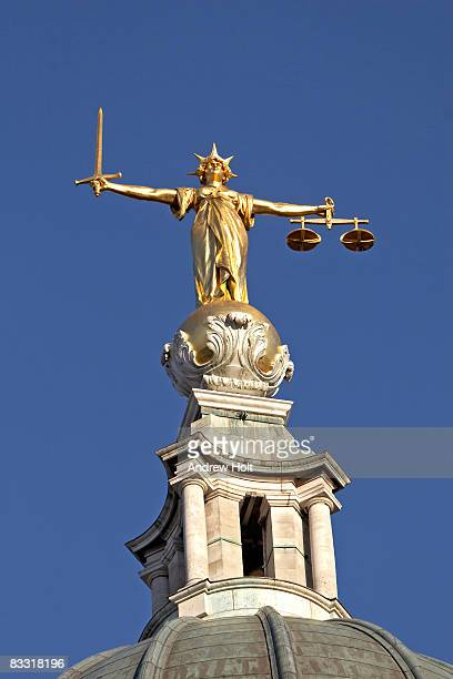 gold statue of justice blue background - lady justice stock pictures, royalty-free photos & images