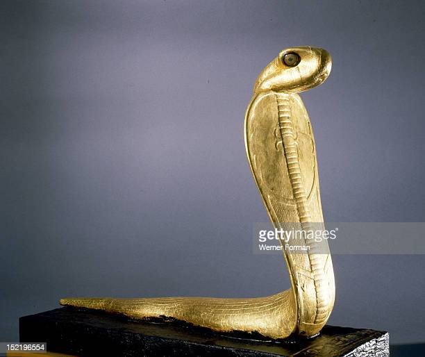 Gold statue of Netjer Ankh made of guilded wood found in one of the black shrines of the Tutankhamun burial, Ancient Egypt. Ancient Egyptian. New...