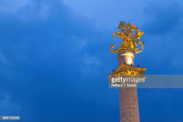 Gold statute of Saint George slaying a dragon.