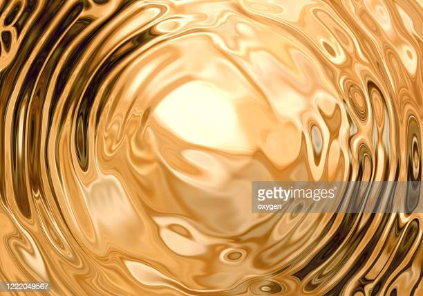 gold swirl fluid melting waves flowing liquid motion abstract background - flüssig stock-fotos und bilder