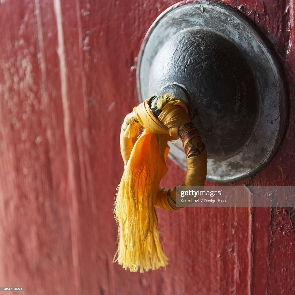 Gold Tassel Tied To A Doorknob On A Red Door Stock Photo   Getty Images