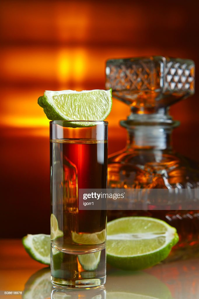 gold tequila and lime : Stock Photo