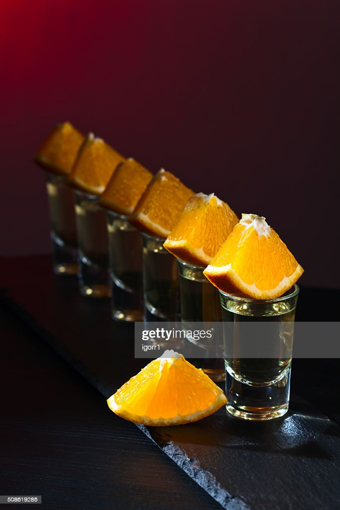 Gold tequila with orange : Stock Photo