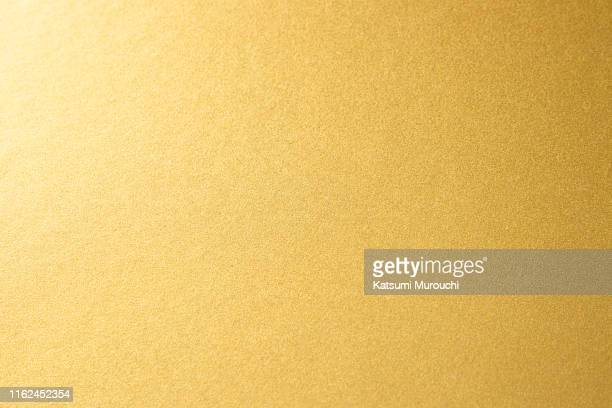 gold texture background - bildhintergrund stock-fotos und bilder