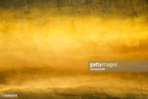 gold texture glitter background. light realistic, shiny, metallic empty golden gradient template. abstract metal decoration. - bronze medalist stock pictures, royalty-free photos & images