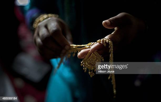 Gold wedding jewelry is laid out for 15 year old Nasoin Akhter on the day of her wedding to a 32 year old man August 20 2015 in Manikganj Bangladesh...