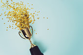 gold winner cup on blue  background