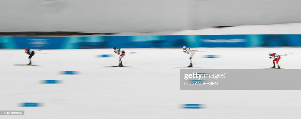 TOPSHOT - (From L) Gold winner Germany's Eric Frenzel, bronze winner Austria's Lukas Klapfer, Norway's Jarl Magnus Riiber, and silver winner Japan's Akito Watabe compete in the nordic combined men's individual normal hill NH/10km cross country at the Alpensia cross country centre during the Pyeongchang 2018 Winter Olympic Games on February 14 , 2018 in Pyeongchang. / AFP PHOTO / Odd ANDERSEN