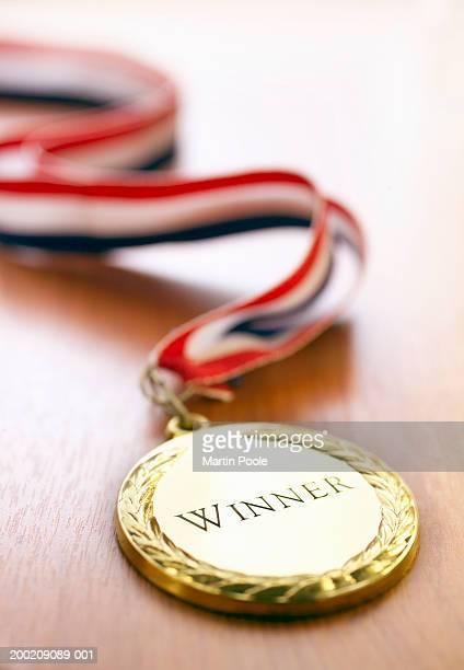 Gold 'Winner' medal, close-up