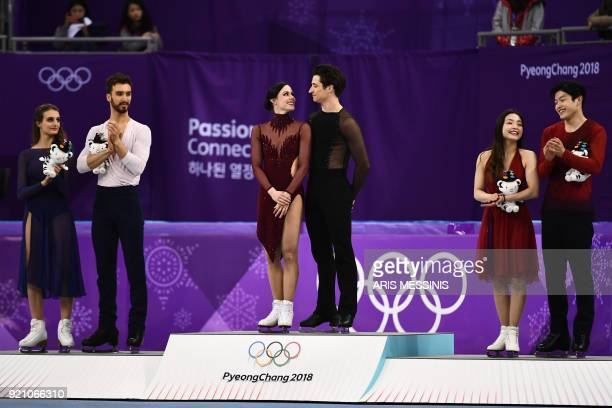 TOPSHOT Gold winners Canada's Tessa Virtue and Canada's Scott Moir silver winners France's Gabriella Papadakis and France's Guillaume Cizeron and...