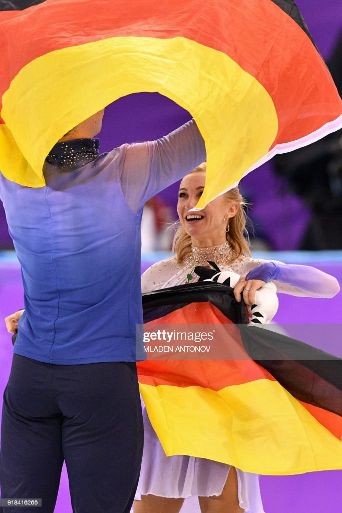 Gold winners Germany's Aljona Savchenko and Germany's Bruno Massot celebrate following the pair skating free skating of the figure skating event during the Pyeongchang 2018 Winter Olympic Games at the Gangneung Ice Arena in Gangneung on February 15, 2018. / AFP PHOTO / Mladen ANTONOV