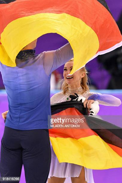 Gold winners Germany's Aljona Savchenko and Germany's Bruno Massot celebrate following the pair skating free skating of the figure skating event...
